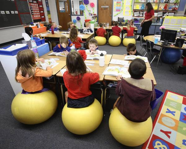 In Stephanie Burnett's first-grade classroom at Seminole Springs Elementary, her students sit on yoga stability balls instead of chairs.