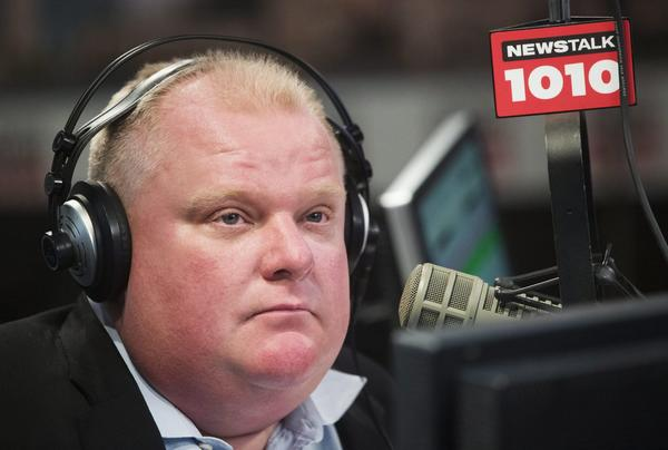 Toronto Mayor Rob Ford talks on his weekly radio show in Toronto on Sunday.