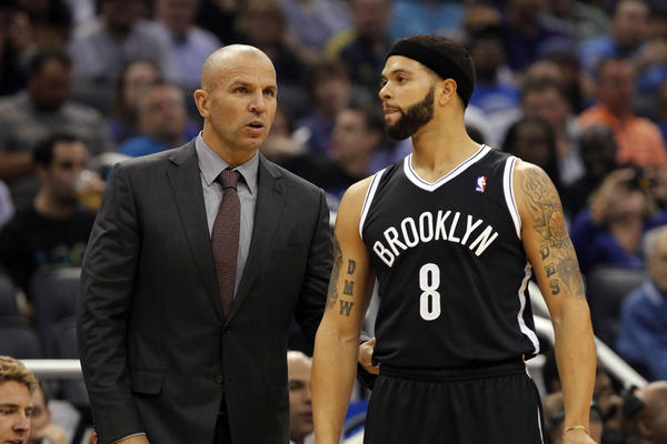 Brooklyn Nets head coach Jason Kidd, left, talks with point guard Deron Williams against the Orlando Magic during the first quarter at Amway Center.