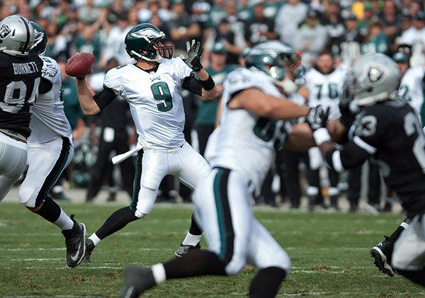 Philadelphia Eagles quarterback Nick Foles (9) throws a touchdown pass to wide receiver Riley Cooper (not pictured) during the second quarter of the game against the Oakland Raiders at O.co Coliseum.
