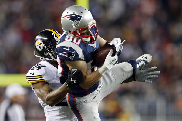 Patriots wide receiver Danny Amendola pulls down a pass in front of Steelers cornerback Ike Taylor during the third quarter at Gillette Stadium.