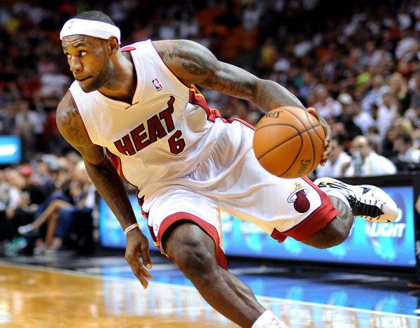 LeBron James works hard towards the basket.