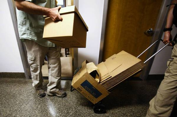 FBI agents remove boxes of documents from the Capitol office of state Sen. Ronald Calderon (D-Montebello) in June.