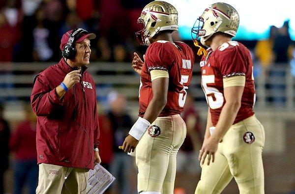 Coach Jimbo Fisher and quarterback Jameis Winston, center, led Florida State to a 41-14 rout of Miami on Saturday to help vault the Seminoles to No. 2 in the BCS standings.
