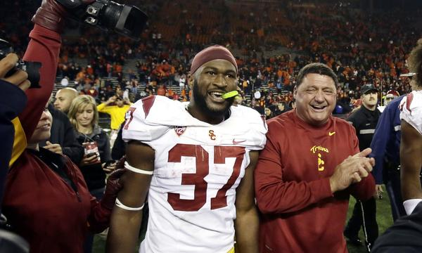 USC Interim Coach Ed Orgeron, right, celebrates with running back Javorius Allen following the Trojans' upset win over Oregon State on Friday. Orgeron says USC is playing with confidence.