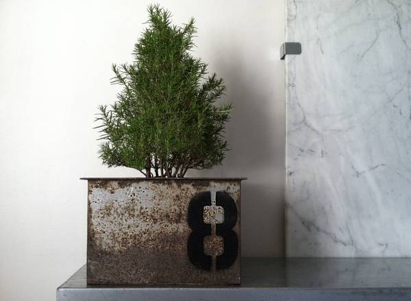Meyghan Hill welds salvaged steel into square planters that she can personalize with custom graphics.