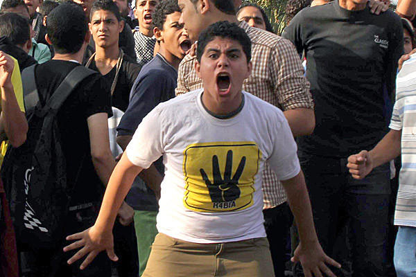 Supporters of ousted Egyptian President Mohammed Morsi protest outside a Cairo courtroom.