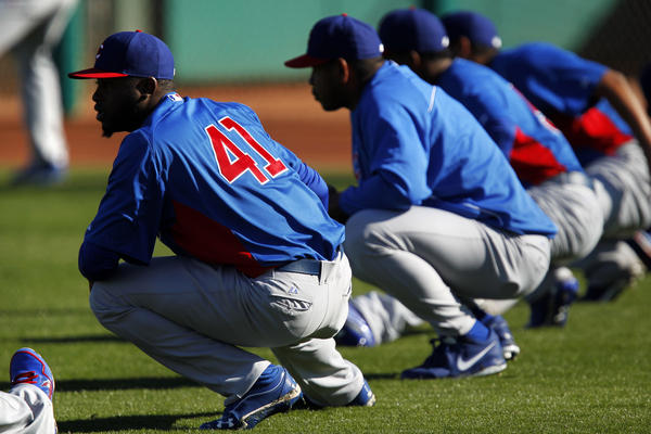 Chicago Cubs relief pitcher Arodys Vizcaino (41) warms up with his teammates during Spring Training in February.