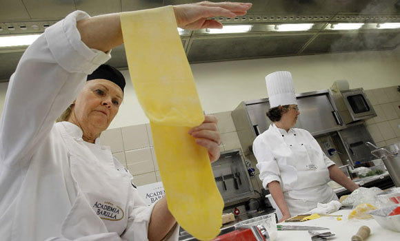 Students make pasta at the Barilla Academy in Parma, Italy, in 2012.