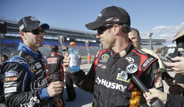 Jimmie Johnson, left, playfully interrupts fellow driver Matt Kenseth during an interview during qualifying for NASCAR Sprint Cup race at the Texas Motor Speedway in Fort Worth.