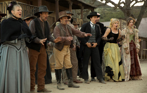 """The cast of Hulu's """"Quick Draw,"""" including John Lehr (holding belt)."""