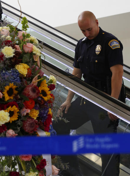 Flowers for slain TSA agent Gerardo Hernandez at LAX Terminal 3.