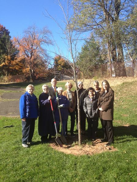 A ceremonial ground-breaking was held at Elmwood Community Center Monday to commemorate the planting of 100 disease-resistant elm trees donated to the town by the West Hartford Garden Club. At left are club President Margaret Pulito, civic projects co-chair Jeanne Grandy and Town Manager Ronald Van Winkle. Director of Human and Leisure Services Helen Rubino-Turco is at right. Members of the garden club are in the middle.