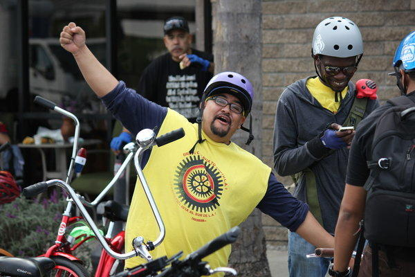Andres Ramirerz of Community Health Councils gets cyclists ready for a ride up Central Avenue from Watts to Little Tokyo on Sunday. At right is Tafarai Bayne of TRUST South L.A.