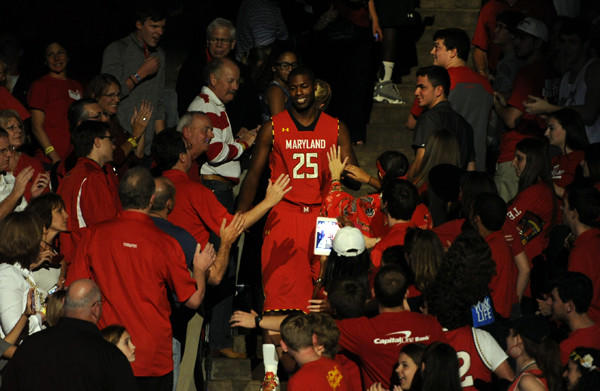 Jonathan Graham walks through the crowd at Cole Field House -- the building where his father once starred -- while being introduced at Maryland Madness last month.