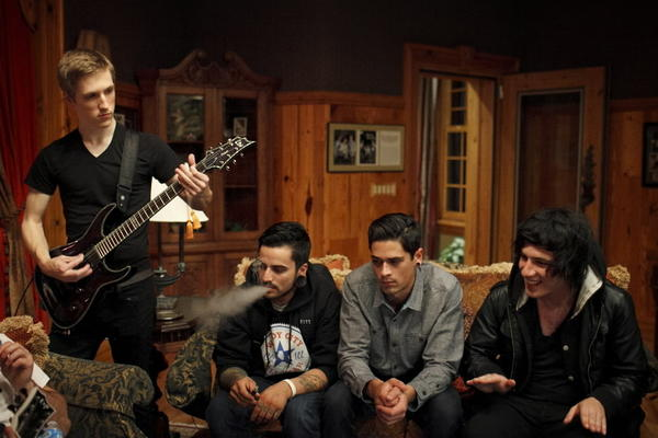 (From left) Jesse Marx, Lino Olvera, Aaron Martinez and Aria Yavarinejad run through an unplugged version of one of For All I Am's new songs Nov. 1, 2013 in Lake Bluff.