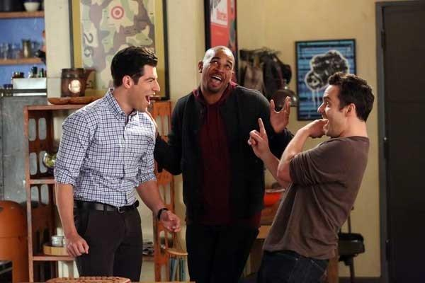 "An old roommate (Damon Wayans Jr., center) visits on ""New Girl."" With Max Greenfield, left, and Jake Johnson."