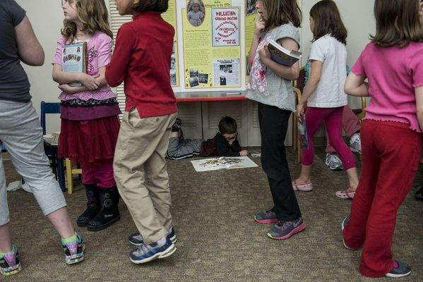 Girls wait at an American Girl series book signing in April at the Arlington Library in Arlington, Va. Girls of all races are entering puberty earlier than ever before, and new suggests that obesity may be a contributing factor.