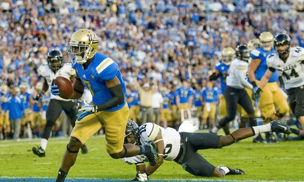 UCLA wide receiver Devin Fuller scores on a 6-yard touchdown reception in front of Colorado's Jeffrey Hall during the second quarter of Saturday's win. Fuller's versatility makes him a potent offensive threat for the Bruins.