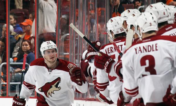 Phoenix Coyotes defenseman Oliver Ekman-Larsson celebrates with his teammates after scoring a goal against the Philadelphia Flyers last month. The Coyotes are getting plenty of offense from their blueline corps.