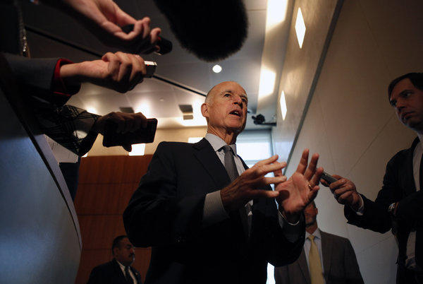 California Gov. Jerry Brown talks with the media after a Cal State Board of Trustees meeting last year.