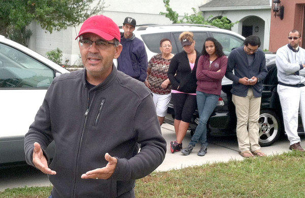 Emilio Suarez, the father of Yessenia Suarez, speaks outside the family's home in Deltona.