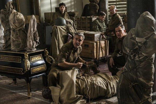 "George Clooney, center, with, from left, Sam Epstein, John Goodman, Bob Balaban and Matt Damon in ""The Monuments Men."""