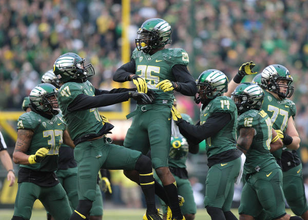 Ducks linebacker Boseko Lokombo (25) after he intercepted the ball in the second half against UCLA.