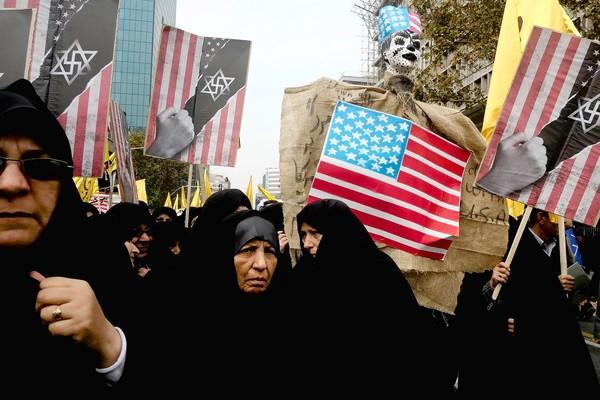 People attend a demonstration in Tehran marking the anniversary of the 1979 U.S. Embassy takeover.