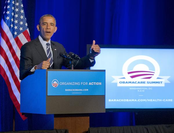 President Obama addresses supporters at a Washington summit on the new healthcare law.