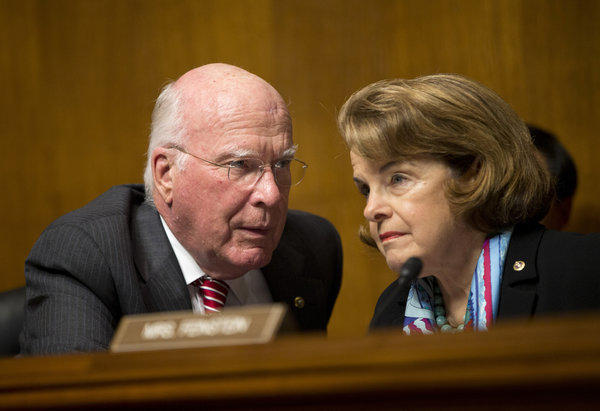 Senate Judiciary Committee Chairman Sen. Patrick Leahy (D-Vt.), left, talks with Sen. Dianne Feinstein, D-Calif., on Capitol Hill during the committee's oversight hearing on the Foreign Intelligence Surveillance Act.