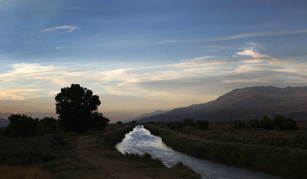 The Los Angeles Aqueduct flows in its unlined channel on the east side of the Sierra Nevada range.