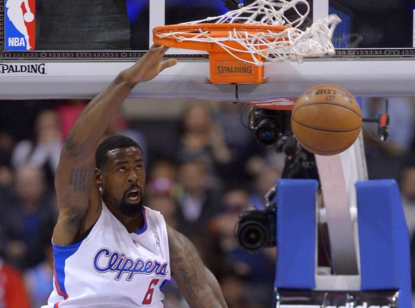 Clippers center DeAndre Jordan dunks during a preseason game against Utah on Oct. 23.