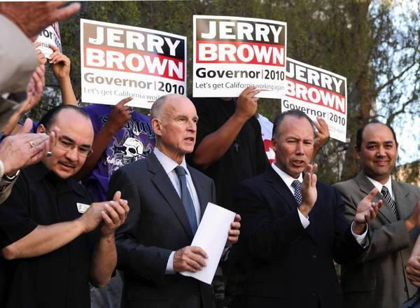 Then a state senator, Dean Florez, second from right, appears in September 2010 with Gov. Jerry Brown at a campaign stop at Laney College in Oakland.