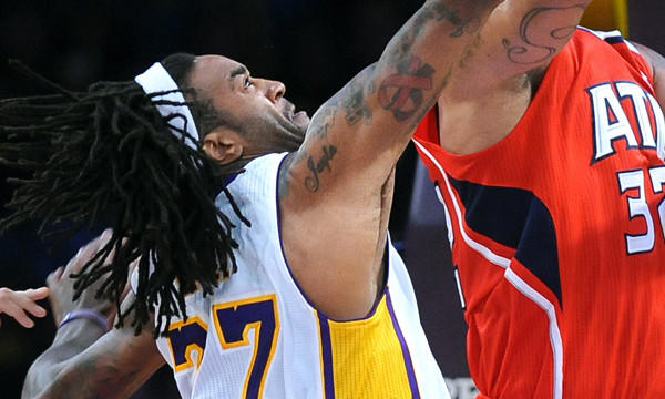 Lakers center Jordan Hill goes up to block a shot during the Lakers' 105-103 win Sunday at Staples Center.