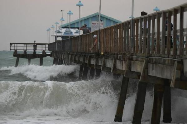 High surf crashes into the Anglins Fishing Pier at Lauderdale-by-the-Sea, Tuesday, Nov. 5, 2013.