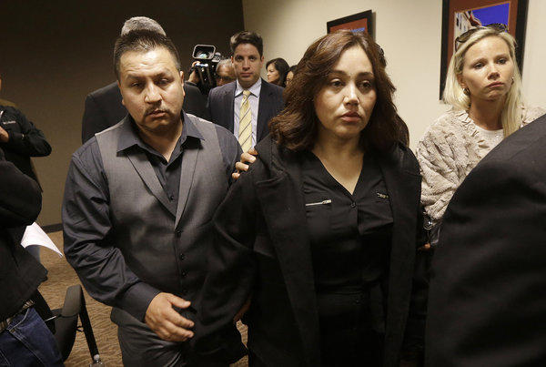 Rodrigo Lopez, left, and Sujay Cruz, parents of Andy Lopez, leave after speaking at a news conference in San Francisco on Monday.