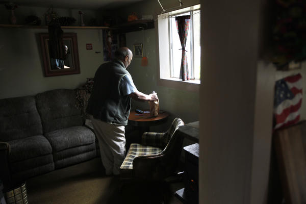 Ed Barrera, 70, heats his home using a wood-burning stove in the foothills of the Sierras.