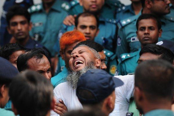An ex-paramilitary soldier reacts following the announcement of his death sentence at a special court in Bangladesh's capital, Dhaka.