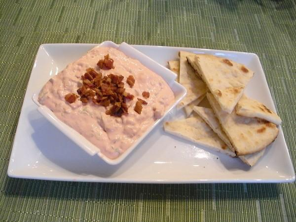 "Serve oven ""fried"" tortilla wedges with a homemade sour cream and bacon dip."