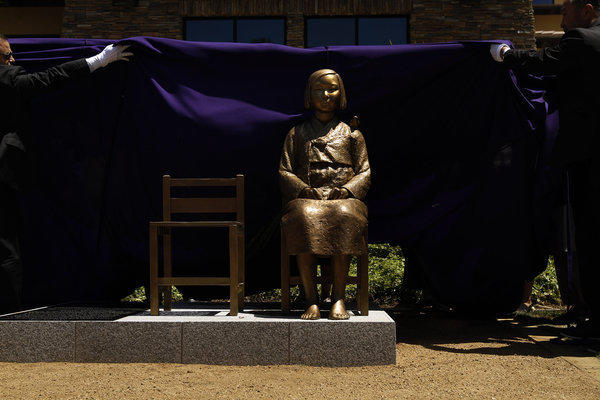A monument remembering Asian women and girls who were held as sex slaves by the Japanese Imperial Army during World War II -- commonly known as comfort women -- was officially unveiled during a ceremony at Central Park in Glendale on July 30.
