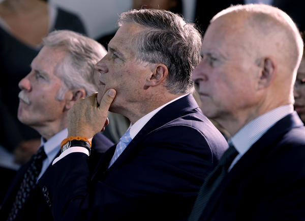 Oregon Gov. John Kitzhaber, Washington Gov. Jay Inslee and California Gov. Jerry Brown, left to right, attend a ceremony in San Francisco to sign an agreement to collectively combat climate change.