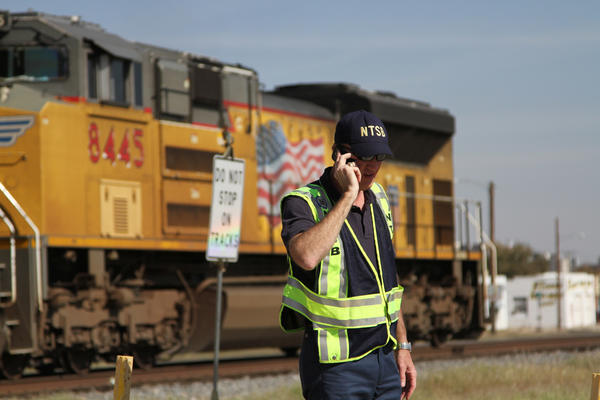 A railroad investigator talks on the phone on Nov. 17, 2012, at the scene of an accident two days earlier in which four veterans were killed and 16 other people were injured when a train slammed into a parade float carrying the returning heroes to a banquet in Midland, Texas.