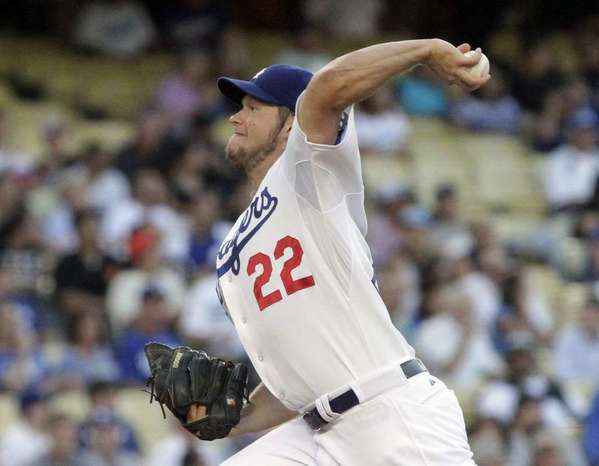 Clayton Kershaw was named NL pitcher of the year in a vote by his fellow major leaguers.