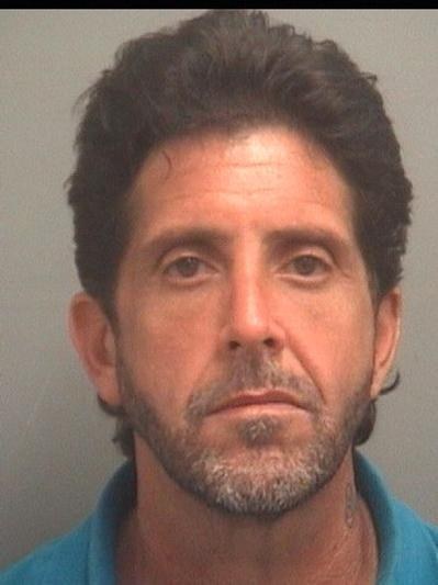 Osvaldo Arencibia, 45, is charged with grand theft.