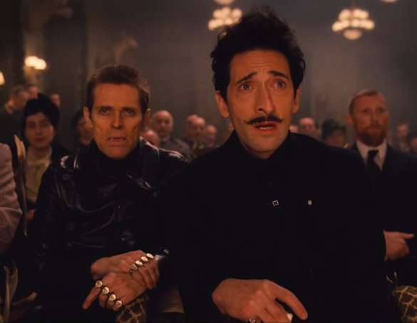 "Willem Dafoe, left, and Adrien Brody appear in ""The Grand Budapest Hotel."""