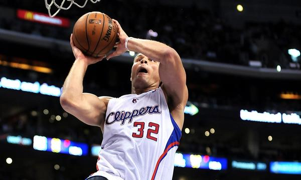 Clippers forward Blake Griffin dunks during the first half of Monday's game against the Rockets.