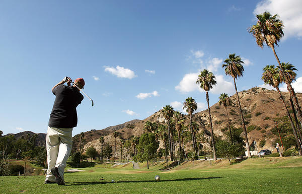 A golfer takes a swing while playing a round of golf at the DeBell Golf Course in the Hillside District of Burbank Thursday afternoon, September 20, 2007.