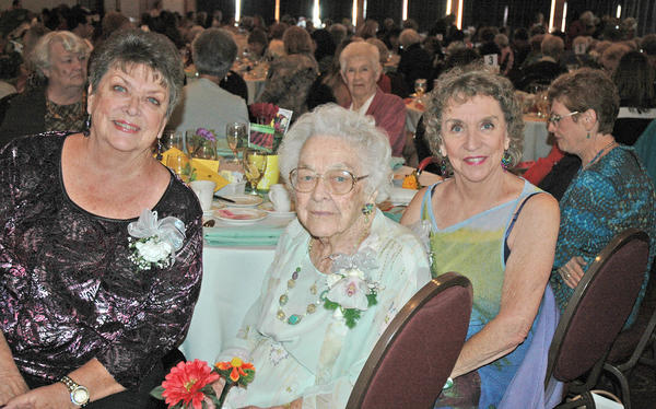Woman of Distinction Gertrude Ness, center, with her daughters Dianne DeGeer, left, and Jo Ness at the Patrons Club fashion show luncheon.