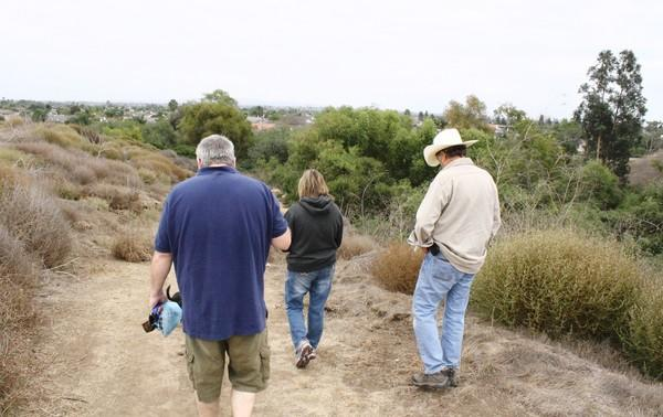 From left to right, Joe Shaw, Suzanne Messina-Cervellon and Mike Cohen tour Bartlett Park.